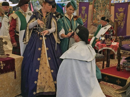 Reenactment of Mary, Queen of Scots, bestowing a knighthood on a loyal subject.
