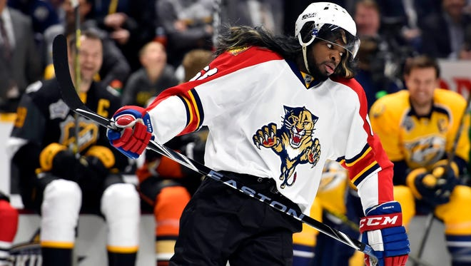 P.K. Subban wears a Jaromir Jagr jersey and mullet wig during the breakaway challenge during the 2016 NHL All Star Game Skills Competition at Bridgestone Arena
