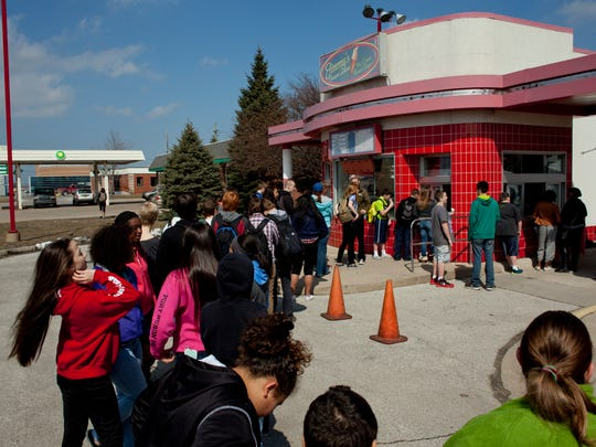 The line wraps around to the front windows during free cone day at Jimmy's Frozen Custard.
