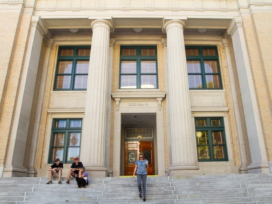 FGCU students Benjamin Djiubek, Josh Hansen and Kristen Sanders gather on the steps of the Old Lee County Courthouse recently.