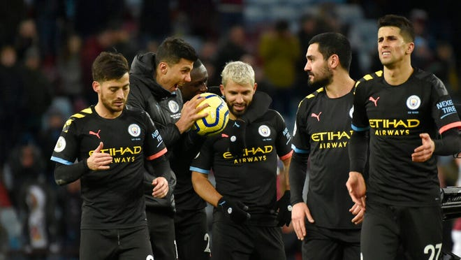 Manchester City's Sergio Aguero, center, with teammates leave the field after the English Premier League soccer match between Aston Villa and Manchester City at Villa Park in Birmingham, England, Sunday, Jan. 12, 2020. Manchester City won the game 1-6.