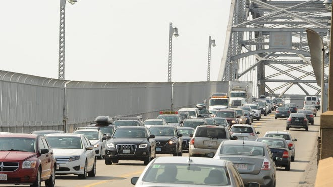 Cars clog the Bourne Bridge as drivers head to the Cape for a long weekend.