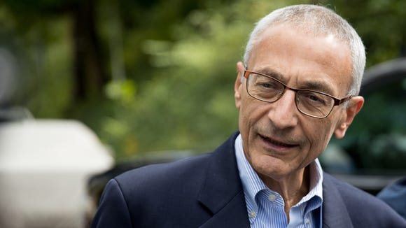Clinton campaign chairman John Podesta speaks to members