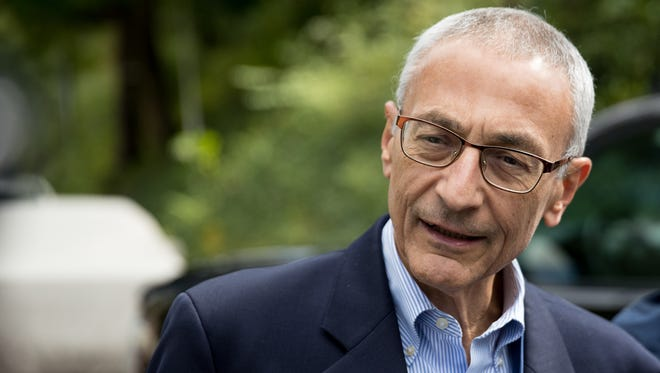 Clinton campaign chairman John Podesta speaks to members of the media outside Hillary Clinton's home in Washington, Oct. 5, 2016.
