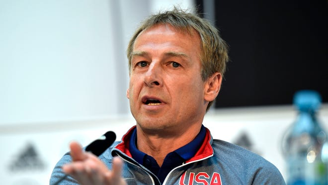 In this June 9, 2015, file photo, U.S. head coach Juergen Klinsmann talks to the media during a news conference in Cologne, Germany. Klinsmann was fired as coach of the U.S. soccer team on Monday, Nov. 21, 2016, six days after a 4-0 loss at Costa Rica dropped the Americans to 0-2 in the final round of World Cup qualifying.