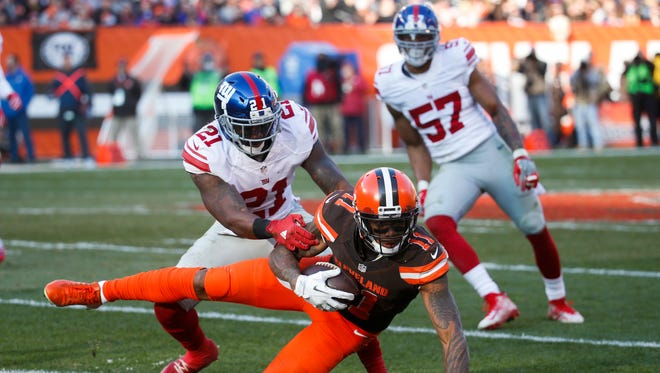 Cleveland Browns wide receiver Terrelle Pryor (11) dives for yardage against New York Giants strong safety Landon Collins (21) during Sunday's game.