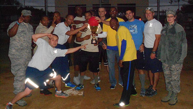 Members of the combined CES-LRS team pose with their trophy after being crowned the 2015 Kickball Champions.