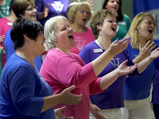 Fox Valley Chorus members Carol Christiansen, left, of Newton, Vicki Powers of Wrightstown, Brenda Krueger of Neenah and Kathy Buss, right, of Shawano sing during a rehearsal Sept. 29 at Grace Lutheran Church in Appleton. The group will participate in the upcoming Sweet Adelines International competition at Las Vegas.
