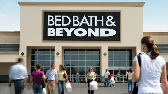 A Bed Bath & Beyond Store front with shoppers walking in and out.