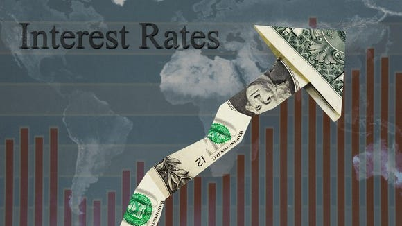 Rising interest rates, as shown by a dollar in the shape of an arrow pointing upward.