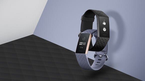 Two Fitbit Charge 3 devices