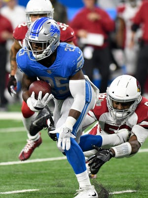 Detroit Lions running back Theo Riddick (25) breaks the tackle of Arizona Cardinals linebacker Karlos Dansby (56) during the first half of an NFL football game in Detroit, Sunday, Sept. 10, 2017. (AP Photo/Jose Juarez)