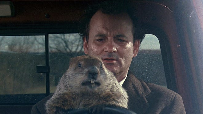 "Bill Murray and a friend take the wheel in the 1993 comedy ""Groundhog Day."""