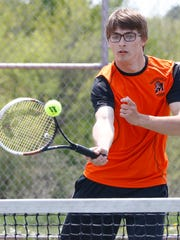 Marshfield's Justin Twardowski creturns a shot during Thursday's Wisconsin Valley Conference tennis meet at Wausau East High School.