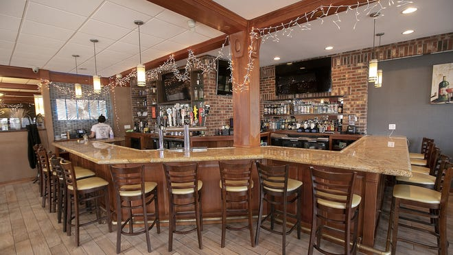 The bar at Flair Restaurant and Bar in Southington, Connecticut, was empty on March 16 while  the business offered curbside pick up during the coronavirus pandemic. The Connecticut Recovery Bridge Loan Program ultimately funded 2,123 one-year, no-interest loans to businesses, averaging $19,705 apiece.