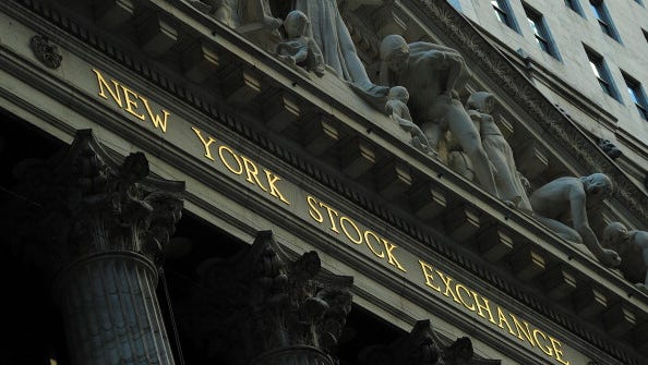 A sign stands outside the New York Stock Exchange in New York.
