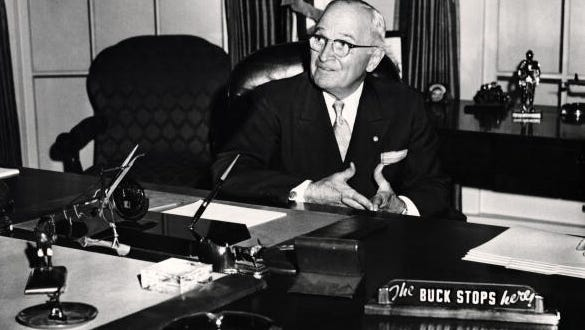 President Harry S. Truman is shown seated in White House library in this file photo, circa 1950. Truman sign the Organic Act of Guam into law on Aug. 1, 1950.