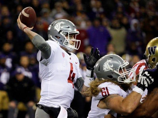 Washington State quarterback Luke Falk throws a pass