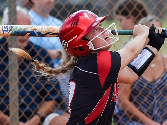 Vero Beach's Alex Jugenheimer (2) watches her hit Friday,