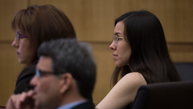 Jodi Arias (right) and her defense attorneys, Kirk Nurmi (center) and Jennifer Willmott (left), listen during the sentencing phase of her retrial at Maricopa County Superior Court in Phoenix on Jan. 22, 2015.