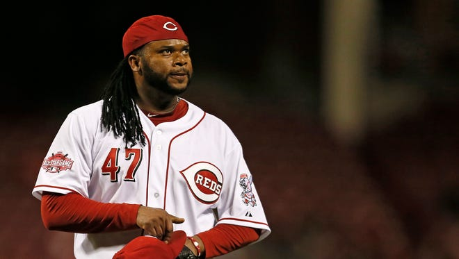 Reds starting pitcher Johnny Cueto walks off the mound after a strikeout for the third out of the top of the top of the sixth inning Thursday night against the Giants.