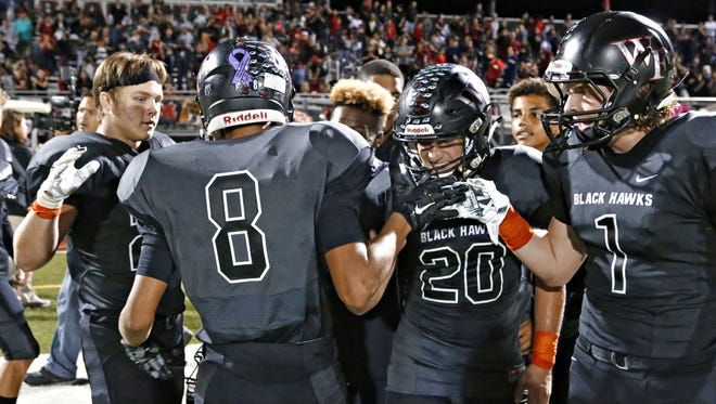 Williams Field's Justis Stokes (8) in congratulated by teammates after scoring at the gun in the fourth quarter to put the icing on the cake in the game between Williams Field HS and Mesa HS at Williams Field HS in Gilbert on October 16, 2015.