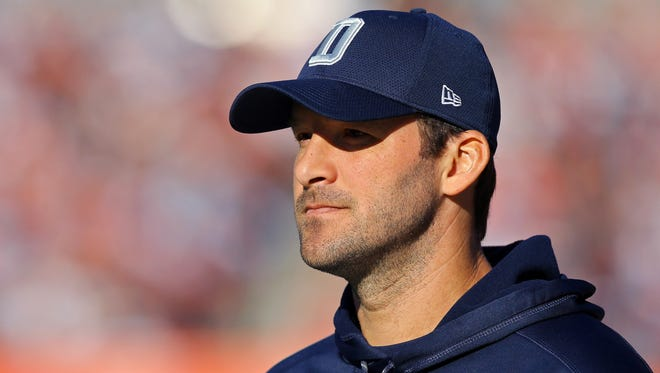 Dallas Cowboys quarterback Tony Romo (9) looks on from the sidelines in the first half at FirstEnergy Stadium.