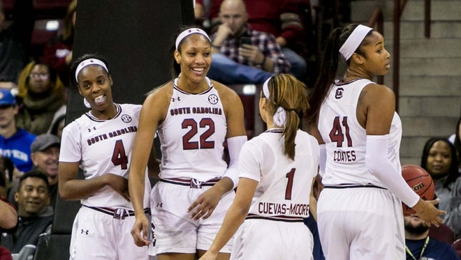 South Carolina Gamecocks guard Doniyah Cliney (4) and South Carolina Gamecocks forward A'ja Wilson (22) and South Carolina Gamecocks guard Bianca Cuevas-Moore (1) celebrate a play against the Minnesota Golden Gophers