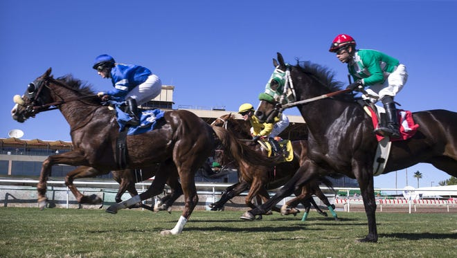 The Arizona Department of Gaming officials are reversing course, now saying a nearly 50-percentfunding reduction will not shut down horse racing and that the agency will end the fiscal year with a surplus.