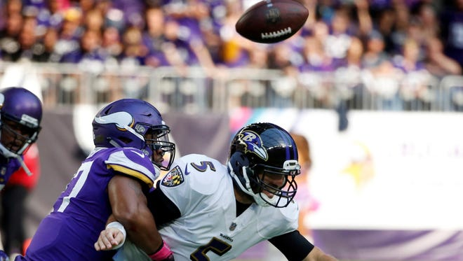 Baltimore Ravens quarterback Joe Flacco (5) fumbles the ball as he is sacked by Minnesota Vikings defensive end Everson Griffen, left, during the second half of an NFL football game, Sunday, Oct. 22, 2017, in Minneapolis.