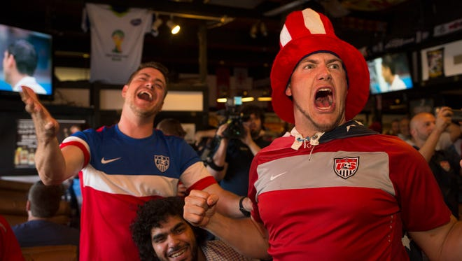 There's no U.S. team in the World Cup this time, but there'great soccer to watch at your favorite pub. In 2014, David Callahan,  George Achkanian and Jonathan Callahan cheered on the U.S.  during the World Cup at the George & Dragon English Pub in Phoenix