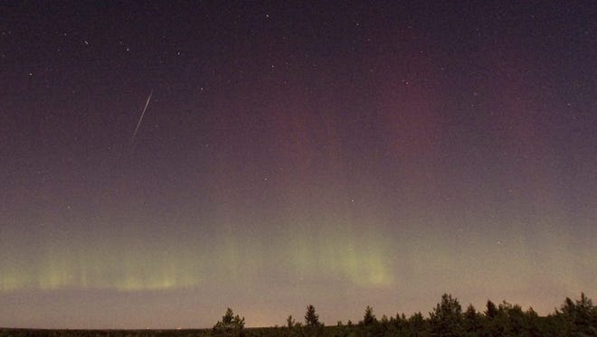 A Draconid meteor and Northern Lights are seen near Skekarsbo, Sweden, on Oct. 8, 2011.