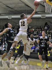 Alamogordo's Jason Campbell extends out his arm during