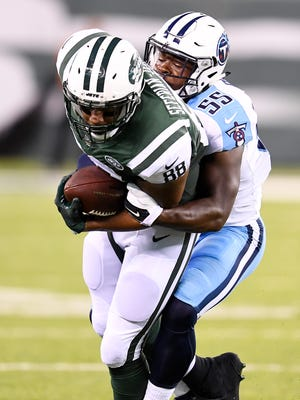 Titans linebacker Jayon Brown (55) pulls down Jets tight end Austin Seferian-Jenkins (88) in the second quarter of a preseason game at MetLife Stadium Saturday, Aug. 12, 2017 in East Rutherford, N.J..