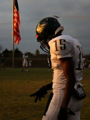 Northwest High's Shatar McClay (15) waits for his drills