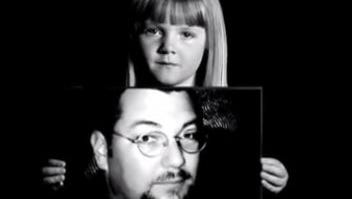 Morgan Jones holds a picture of her father, Steven Lee Jones, for a suicide prevention ad produced several years ago. Steven Jones killed himself in November 2007.