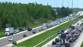 A rollover crash along I-75 southbound blocked several lanes of the freeway on Sunday afternoon.