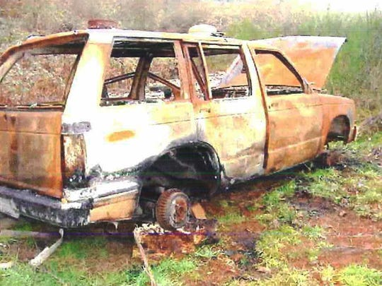 A burned-out car at 6331 Liberty St. S in Salem. The 115-acre property has been listed as a drug lab location for more than 10 years.