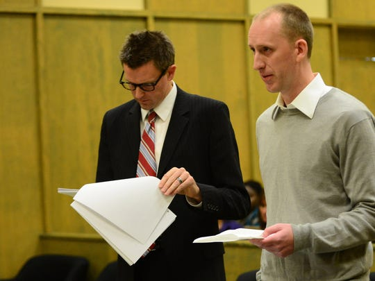 Emrance Berger (right), with his attorney Jason Thompson, addresses the court during his sentencing at Polk County Courthouse in Dallas on Monday, Nov. 10, 2014. Berger has been sentenced to 38 months in prison and five years of post-prison supervision.