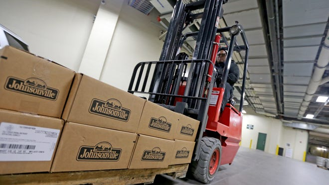 Harold Webster, a concession porter, uses a forklift to move a pallet of Johnsonville brats in the food service area at Lambeau Field in preparation for a game last season.
