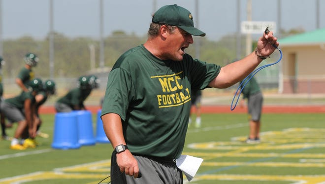 Melbourne Central Catholic football coach Stacy Sizemore encourages his players during practice Tuesday afternoon.