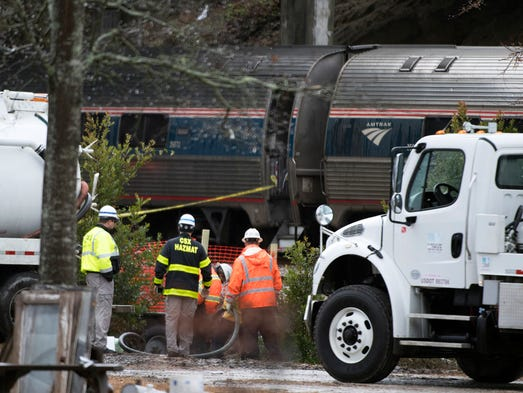 Derailed Amtrak cars are seen at the scene of the crash