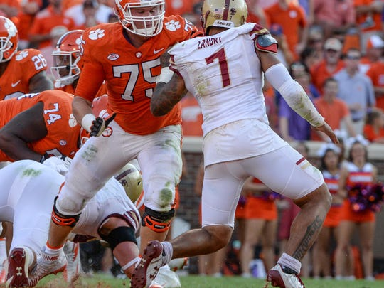 Clemson tackle Mitch Hyatt (75) blocks Boston College defensive end Harold Landry(7) during the fourth quarter in Memorial Stadium at Clemson on Saturday.