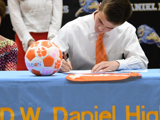 D.W. Daniel senior John Martin signs to play soccer