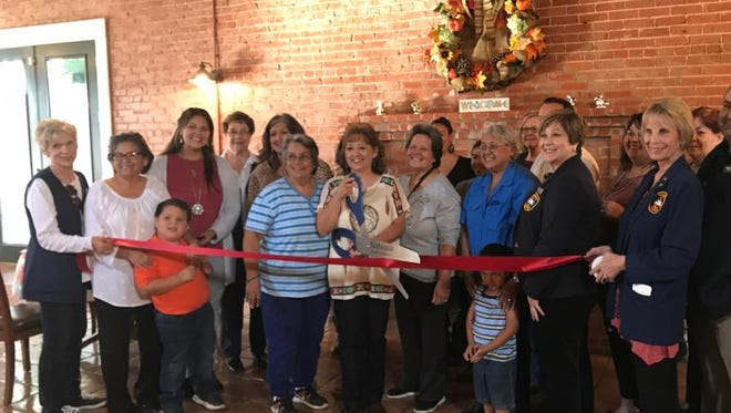 Family and friends of Edwina Cervantez, seen here holding the ceremonial scissors, celebrated the grand opening of Cake Creations by Edwina on Oct. 25, located at 506 S. Chadbourne St. The shop specializes in custom sweet treats, and has event space available for rent.