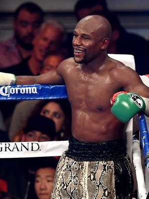 Floyd Mayweather Jr. looks on while taking on Marcos Maidana during their WBC/WBA welterweight title fight at the MGM Grand Garden Arena in 2014.