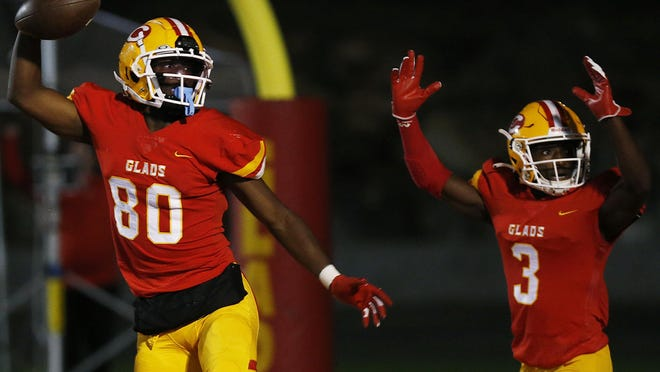 Clarke Central's Rio Foster (80) celebrates with Clarke Central's Jairus Mack (3) during an GHSA high school football game between Clarke Central and Loganville in Athens, Ga., on Friday Nov. 6, 2020. Clarke Central won 35-16.