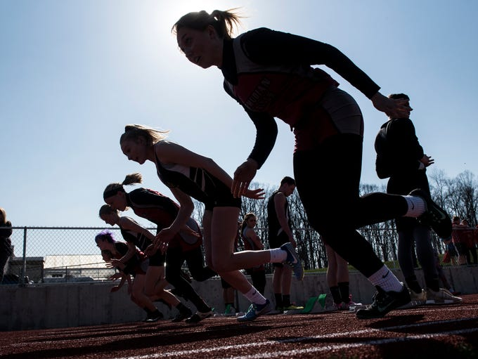 Girls take off during the 100-meter dash, Wednesday,