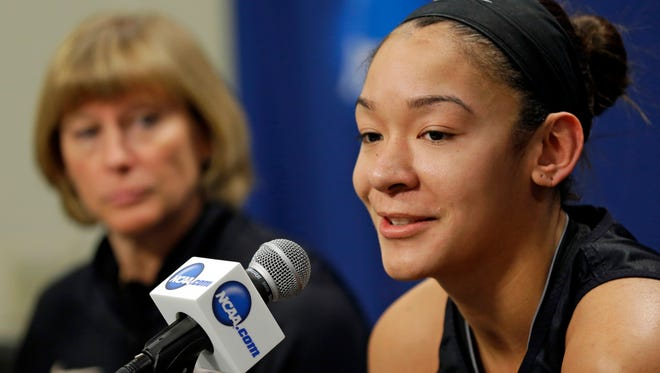 Purdue head coach Sharon Versyp, left, listens as forward Whitney Bays answers a question during an NCAA women's college basketball tournament news conference in West Lafayette, Ind., Sunday, March 23, 2014. Purdue faces Oklahoma State in a second round game on Monday. (AP Photo/Michael Conroy)