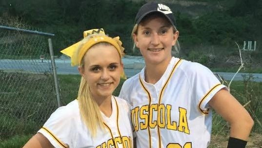 Tuscola rising junior Melody Hannah, right, and Mountaineers catcher Heather Carver.